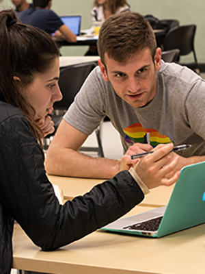 Library undergraduate fellow Ross Mattheis, right, helps student Dafna Bearson at the Data and Reference Help Desk in the Moffitt Library on April 10, 2018. (Photo by J. Pierre Carrillo for the UC Berkeley Library)