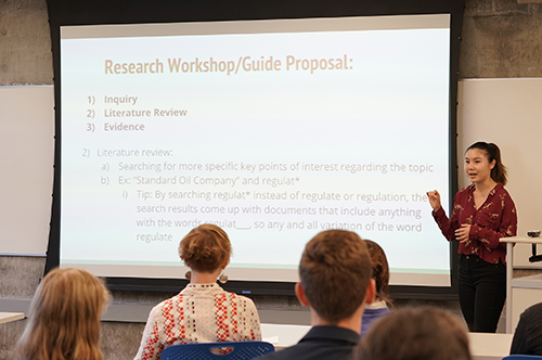 Undergraduate Library Fellow Caitlin Cozine, left, presents her research with Kristina Smelser, at the Undergraduate Library Fellows showcase on May 1, 2018. Their research focuses on students using the reference desk at Doe Library. (Photo by Cade Johnson for the UC Berkeley Library)